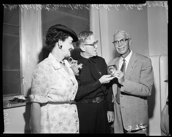 Chief ambulance attendant of L.A. Receiving Hospital retires, 1957