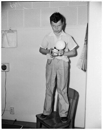 Junior photographer at Miss Universe contest, 1953