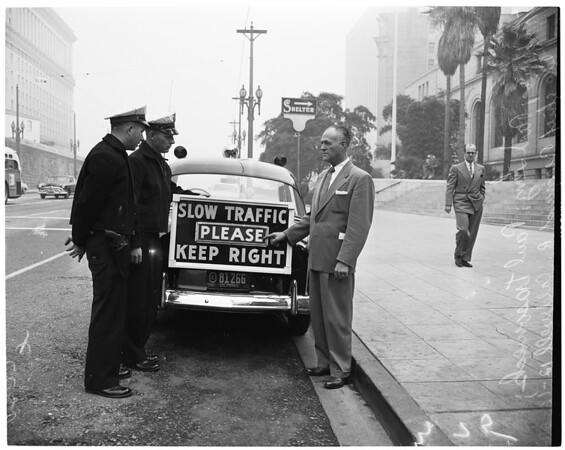 Detail 1 of 3, New sign on Los Angeles police car, 1952