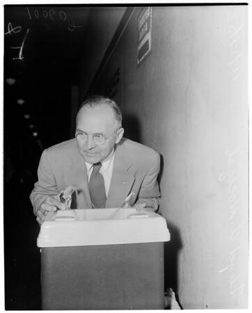 Defendant in water dousing, 1953