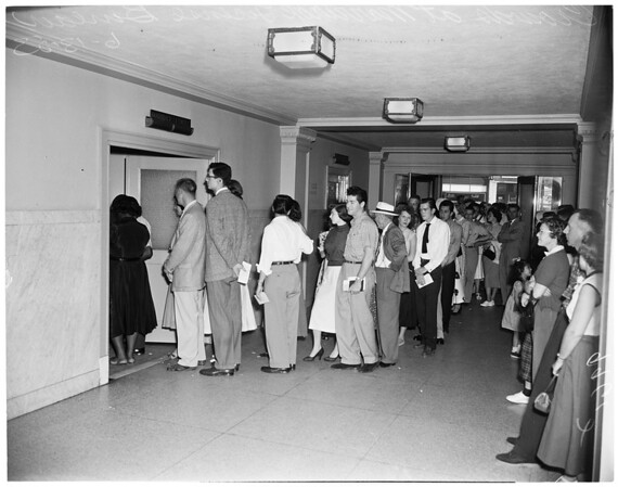 Crowds of couples waiting in line at Marriage License Bureau, 1953