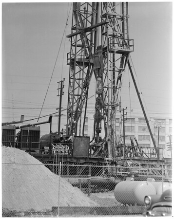 Detail 6 of 6, Oil well being drilled near downtown Los Angeles, 1960
