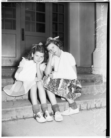 Sisters break arms at school at same day (Glendale), 1954