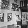 Italian artist (with some of his paintings), 1953