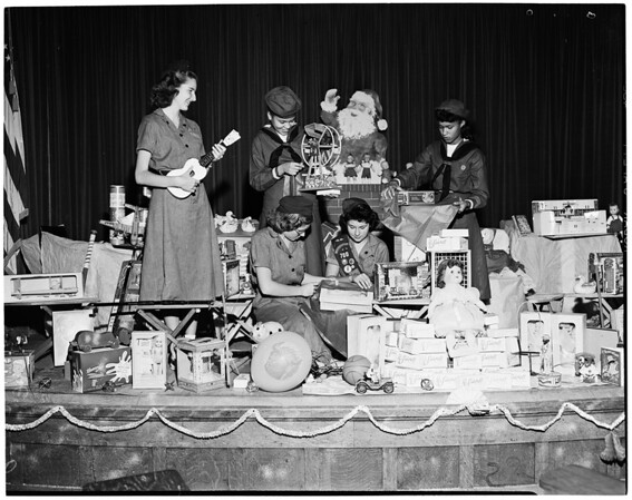 Detail 2 of 2, Christmas gifts wrapped for orphans' party, 1952