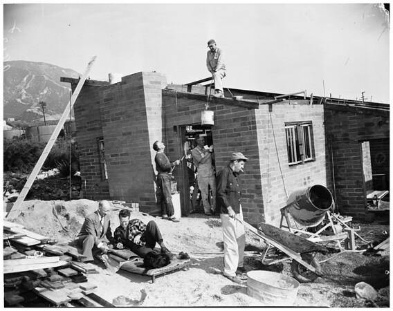 Helps sculpter build house (La Crescenta area), 1953
