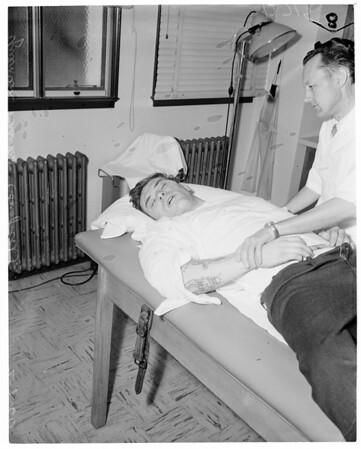 Robbery suspect captured, 1960