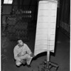 Man caught in experimental cooling tower at 2500 South Atlantic Boulevard, 1954