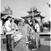 Chinese American women donate blankets to Korean children, 1953