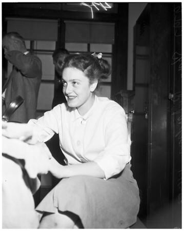 Girl receives stolen goods from holdup gang, 1953