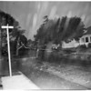 Light poles down at 46th Street between San Pedro Street and Avalon Boulevard, 1954