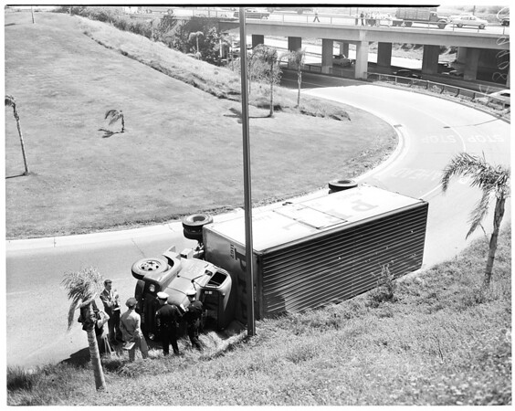 Truck overturned at 7th Street turnoff of Santa Ana Freeway, 1954