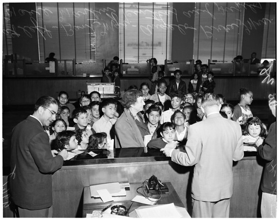 Retiring school teacher and school kids at bank -- Lincoln Heights branch of Bank of America, 1953