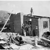 Helps sculpter build house (La Crescenta area), 1953