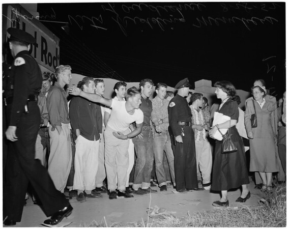 Progressive Party meeting in Culver City at which Young Korean War Veterans protest communist influence and attendance, 1952