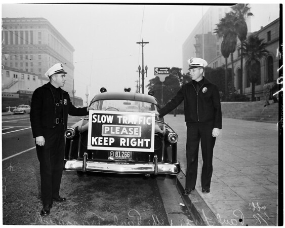 Detail 2 of 3, New sign on Los Angeles police car, 1952
