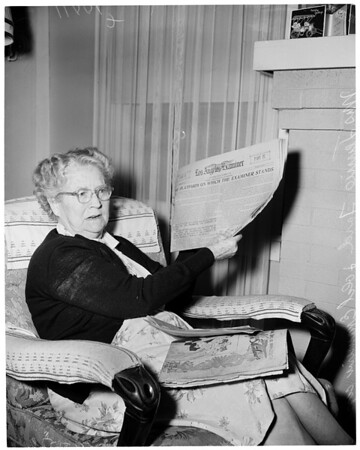 Woman with first Sunday Examiner, 1953