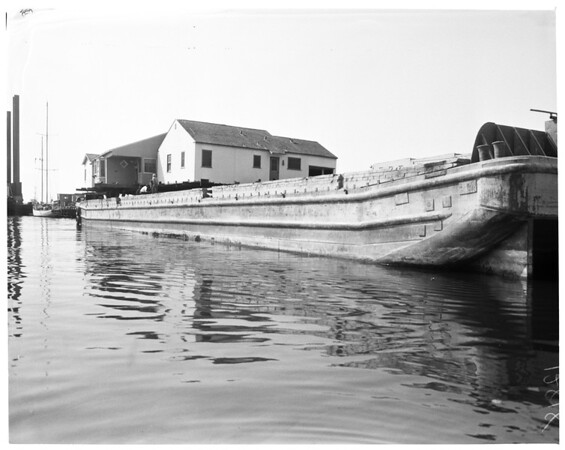 Houses being moved by tug boat, 1960