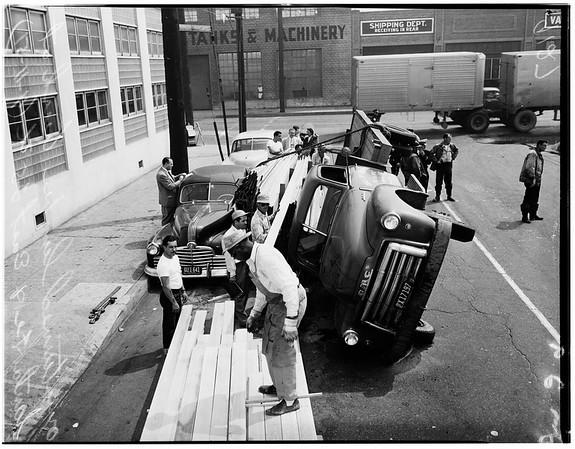Lumber truck overturned -- Santa Fe and East 25th Street, 1951