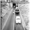 Cotton truck stuck in underpass at Washington and Santa Fe, 1951