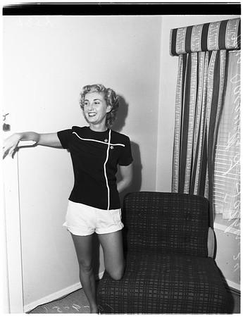 Girl followed by admirer, 1951