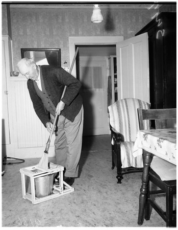 Inventor of non-tipable rack for mop bucket, 1951