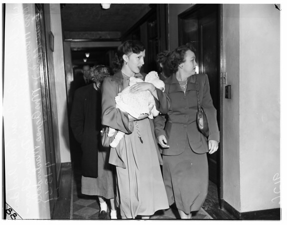 Four women walking with baby, 1951