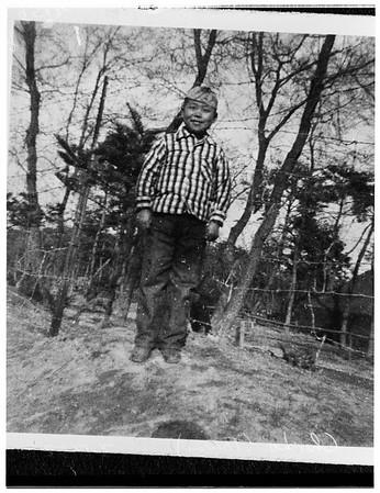 Soldier adopts Korean boy, 1952