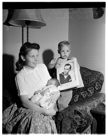 Sailors family with newest arrival, 1951