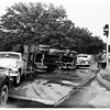 Truck hits two cars and overturns, 1951