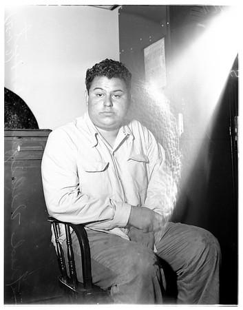 Burglary suspect in university jail, 1951