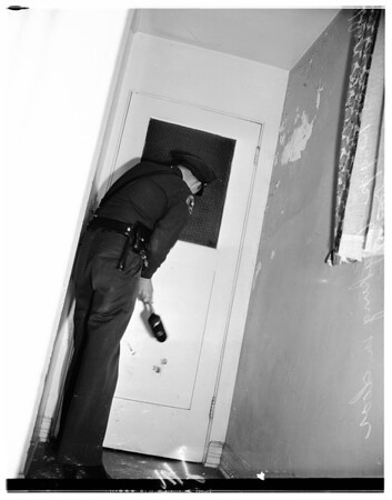 Sheriff's deputies break into 400 South Rossmore, 1951