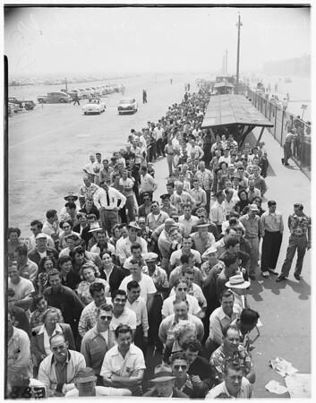 Douglas employees lineup for paychecks, 1951