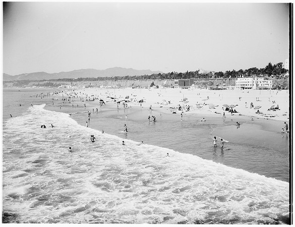 Warm weather crowd at beach..., 1951
