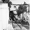 Car through garage (Coronado Terrace), 1951
