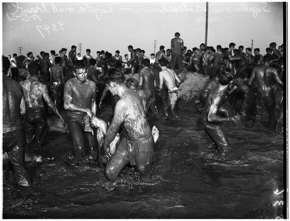 Sack Race,  Tug of War, and Mud Fight at Loyola University, sophomores and freshmen,1951.