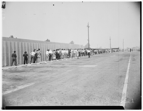 Douglas employees lineup for paychecks, 1951