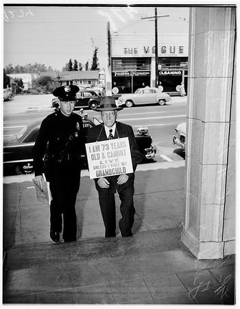 Grandpa Fred Feld on picket line in front of grandchild's home, 1951