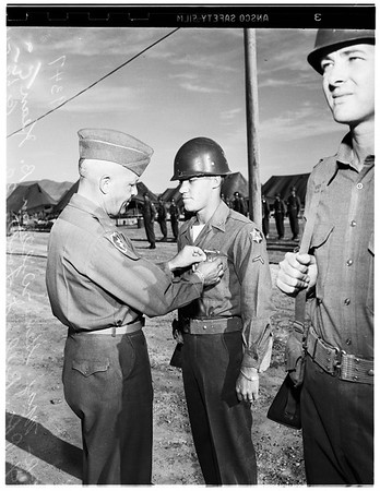 Bronze Star Medal...General pins medal on Private First Class, 1951.