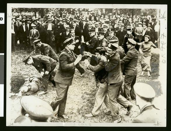 Policemen subduing communist demonstrators, Worcester, Mass., 1934
