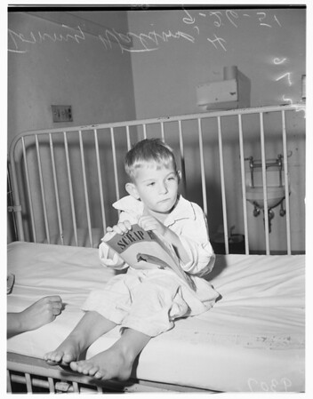 Mother gives narcotics to her child, 1951
