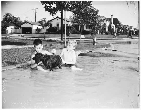 Broken water main at 96th Street and Harvard Boulevard, 1951