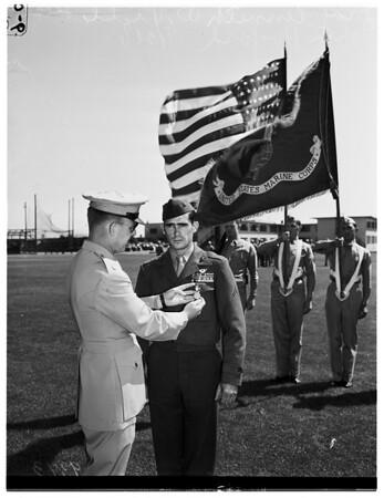 Hero receives medal, 1951