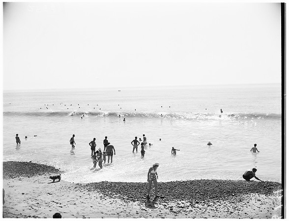 Warm weather crowd at beach..., 1951