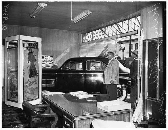 Auto through window of building, 1951