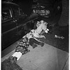 Cat rescued from auto frame (1906 East 5th Street in Long Beach), 1951