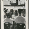 Teenagers watch sports on church-operated video screen, 1948