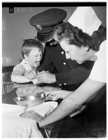 Kid gets nut caught on finger (Van Nuys Hospital), 1951