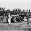 Demolished house trailer and auto go over twleve-foot embankment at Malibu Grade, 1951