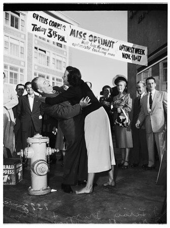 """Optimist Week Celebration""... Optimistic Man Kissed by Miss Santa Monica Bay Optimist and City College student, 1951"
